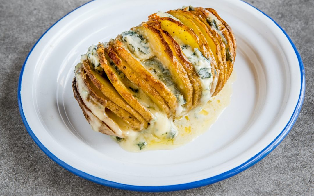 Hasselback potatoes with creamy blue Cantorel gratin